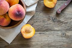 Peaches. Fresh Organic Peaches on rustic wooden background with copy space. Sweet summer peaches Stock Images