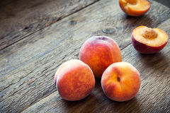Peaches. Fresh Organic Peaches on rustic wooden background with copy space. Sweet summer peaches Royalty Free Stock Image