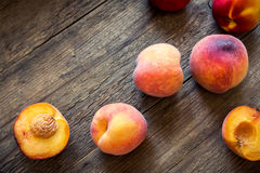 Peaches. Fresh Organic Peaches on rustic wooden background with copy space. Sweet summer peaches Royalty Free Stock Photo
