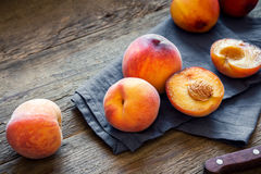 Peaches. Fresh Organic Peaches on rustic wooden background with copy space. Sweet summer peaches Stock Photography
