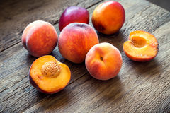 Peaches. Fresh Organic Peaches on rustic wooden background with copy space. Sweet summer peaches Royalty Free Stock Images