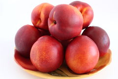 Peaches. Fresh peaches on the plate Royalty Free Stock Photos