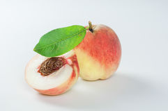 Peaches with green leaf Stock Photo