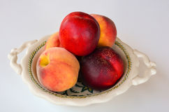 Peaches in fruit bow Stock Photos