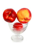 Peaches in a glass bowl Stock Photo