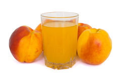Peaches and glass of juice Stock Photography