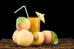 Peaches and glass with juice Stock Photography
