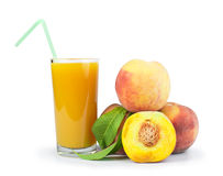 Peaches and glass with juice Royalty Free Stock Image