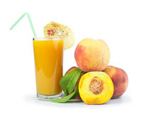 Peaches and glass with juice Stock Photo