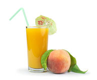 Peaches and glass with juice Royalty Free Stock Photography