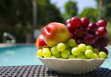 Peaches and grape by the swimmimg pool Royalty Free Stock Photo