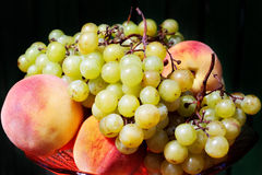 Peaches and grapes Royalty Free Stock Photos