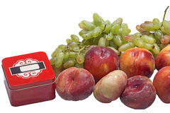 Peaches and grapes and box Royalty Free Stock Photo