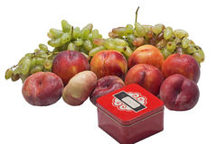 Peaches and grapes and box Royalty Free Stock Image