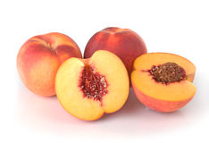 Peaches In A Group With One Halved Royalty Free Stock Photography