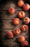 Peaches group in rustic wooden box. Peaches group in old rustic wooden box and dark background Stock Images