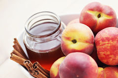 Peaches with honey and cinnamon Royalty Free Stock Image