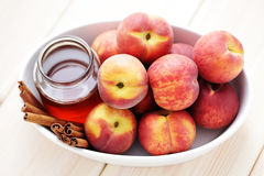 Peaches with honey and cinnamon Stock Photography