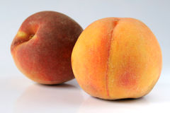 Peaches isolated. Pair of peaches isolated Stock Images