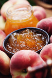 Peaches jam. Homemade delicious peaches jam - goods in jar Stock Images