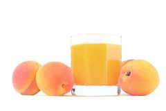 Peaches juice. Glass of freshly squeezed juice and three peaches isolated on white background Stock Image