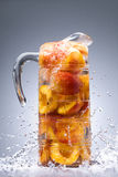 Peaches with juice in a jug Royalty Free Stock Images