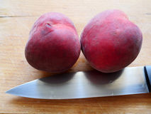 Peaches on a knife`s blade Stock Photo
