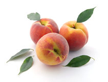 Peaches and leaves Royalty Free Stock Image