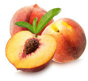 Peaches with leaves isolated on the white background.  Stock Images