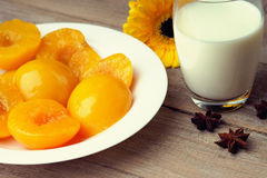 Peaches, milk, gerber and anise. On a table Stock Image