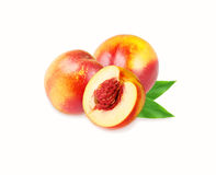 Peaches nectarine on white. Peaches with leaves royalty free stock image