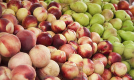 Peaches, nectarines and pears on display at a farmer market. Fruit background. Healthy eating. Stock Photo