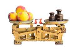 Peaches on old scales Royalty Free Stock Photos