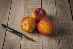 Peaches on a old wooden table Royalty Free Stock Photography