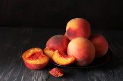 Free Peaches On Black Stock Photos - 74992343