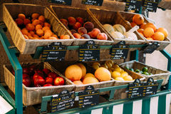Peaches and other fruits on local grocery market Royalty Free Stock Photo