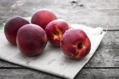 Peaches over wooden background Royalty Free Stock Image