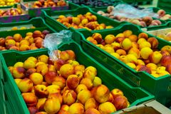 Peaches Packed boxes lying on the counter of the supermarket royalty free stock image