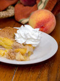 Peaches and a Peach cobbler dessert close up Royalty Free Stock Image
