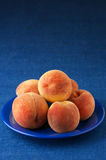 Peaches in plate Royalty Free Stock Photos