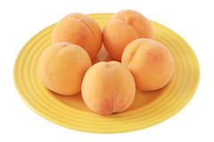 Peaches on a plate Stock Image