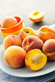 Peaches on plate Stock Image