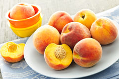 Peaches on plate. Ripe juicy peaches on a plate ready to eat Stock Images
