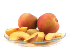 Peaches on a plate Stock Images