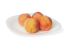 Peaches on the plate Royalty Free Stock Photos