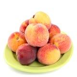 Peaches on a plate Stock Photos