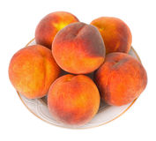 Peaches on a Plate. Juicy peaches on a plate over white background Royalty Free Stock Image