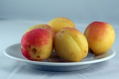 Peaches on a plate Royalty Free Stock Photos