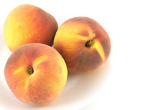 Peaches on plate isolated over white close up Stock Photos