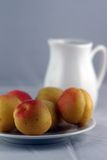 Peaches on a plate Royalty Free Stock Photo